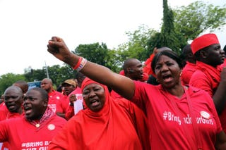 Members of the Bring Back Our Girls group campaigning for the release of the Chibok schoolgirls kidnapped by Boko Haram march to meet with the Nigerian president in Abuja on July 8, 2015.PHILIP OJISUA/AFP/Getty Images