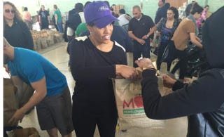 Baltimore Mayor Stephanie Rawlings-Blake assists residents at food pantry.@MayorSRB/Twitter
