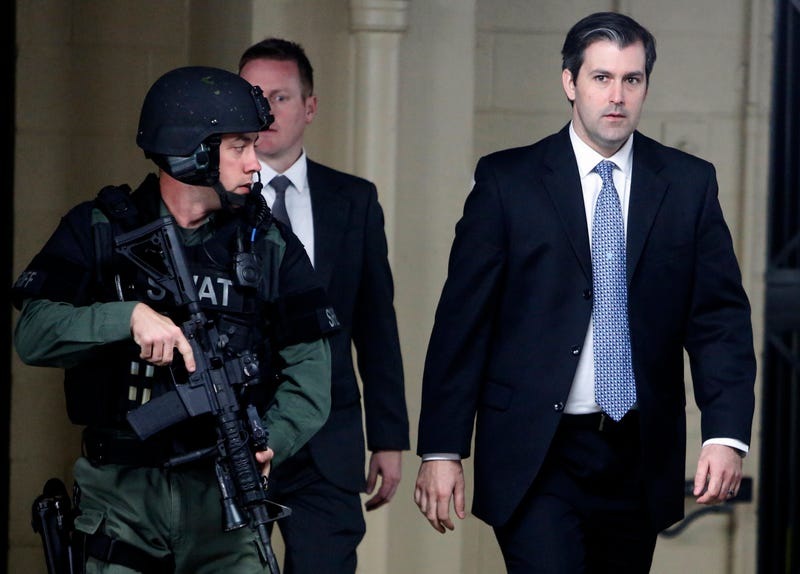 Michael Slager (right) walks from the Charleston County Courthouse under the protection of the Charleston County Sheriff's Department after a mistrial was declared for his trial in Charleston, S.C., on Dec. 5. 2016.  (Mic Smith/File/AP Images)