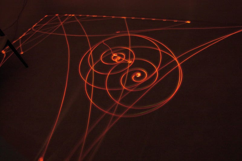 Illustration for article titled Geometric Light Paintings Drawn by Roombas