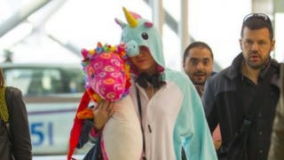 Illustration for article titled Miley Cyrus Flew To Australia In A Unicorn Onesie
