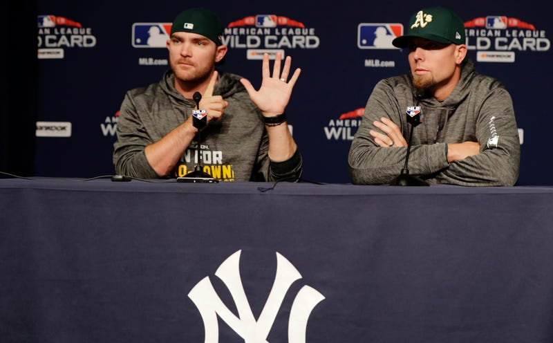 Liam Hendriks and Blake Treinen. Hendriks is possibly attempting to count how many different pitchers the A's will use over the first six innings.