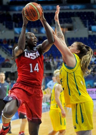 Tina Charles vies for the ball with Australia's Cayla Francis during the 2014 FIBA Women's World Championships game Oct. 4, 2014, in Istanbul.  OZAN KOSE/AFP/Getty Images