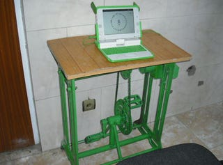 Illustration for article titled Pedal-Powered OLPC Tested in Afghanistan: Free Power (and Killer Calves) For All