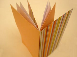 Illustration for article titled Bind Paper Into a Booklet With Just Some Clever Folds and Cuts