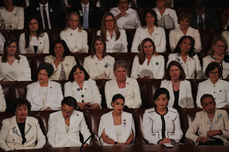 Female lawmakers dressed in white watch as President Donald Trump delivers the State of the Union address in the chamber of the U.S. House of Representatives at the U.S. Capitol Building on February 5, 2019 in Washington, DC. A group of female Democratic lawmakers chose to wear white to the speech in solidarity with women and a nod to the suffragette movement.