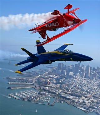 Illustration for article titled Bi-Plane Pilot Does Best Maverick Impression Atop Blue Angel