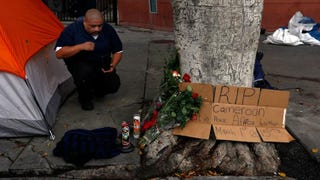 A memorial set up for Charly Keunang on March 2, 2015, the day after he was killed on Skid Row in Los  AngelesLos Angeles Times screenshot