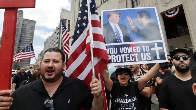 Iraqis and supporters rally outside the Theodore Levin United States Courthouse, Wednesday, June 21, 2017 in Detroit. Image via the AP.