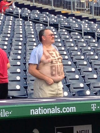 Illustration for article titled Pittsburgh Fan With Sign Sculpted Into His Body Hair Invades D.C.