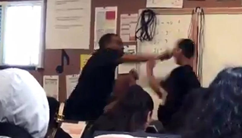 Marston Riley punches his 14-year-old student after being repeatedly provoked