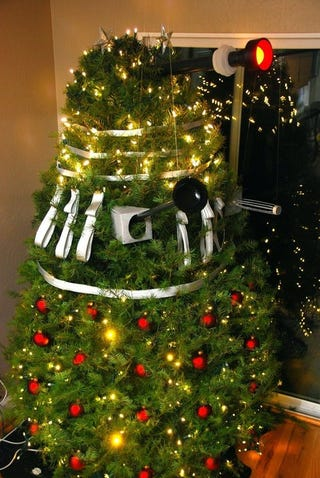 Illustration for article titled Dalek disguised as a Christmas Tree waits to exterminate Santa Claus