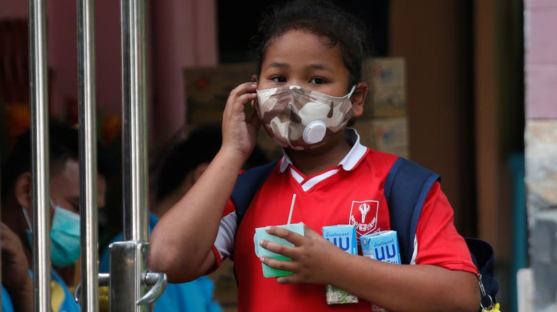 A young girl leaves school, which is out for the week as a result of the awful air pollution.