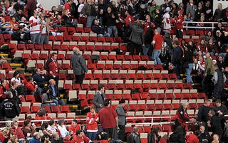 Illustration for article titled Wings Fans Do Their Little Turn On The Catwalk, Get Arrested