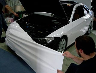 Illustration for article titled BMW Owner Changes His 3-Series Color From Black To White... With Tape