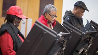 Residents of Ferguson, Mo., cast their votes at a local polling place Nov. 4, 2014. Community leaders are hoping for high voter turnout among African Americans in municipal elections April 7, 2015.Scott Olson