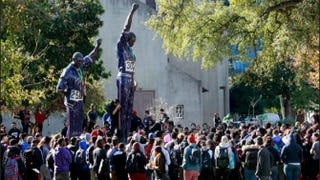 Protestors gather around a statue on San Jose State University's campus after allegations that four white students tortured a black student surfaced.youtube
