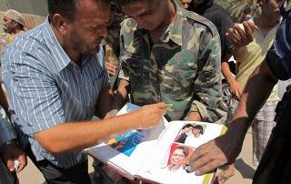 Illustration for article titled Qaddafi's Condoleezza Rice Photo Album