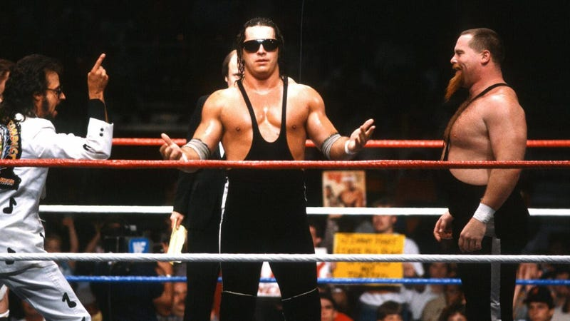"""Bret """"Hitman"""" Hart circa 1986 with manager Jimmy Hart and tag team partner Jim """"The Anvil"""" Neidhart."""