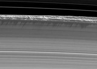 Illustration for article titled Two-mile-high mountains discovered in Saturn's rings