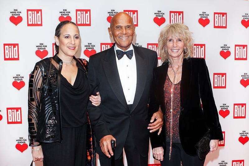 Gina Belafonte with her father, Harry Belafonte, and his wife, Pamela Frank, at the Ein Herz fuer Kinder Gala 2014 at Tempelhof Airport on Dec. 6, 2014, in Berlin (Isa Foltin/Getty Images)
