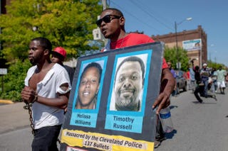 People march in protest May 23, 2015, to the Cuddell Recreation Center in Cleveland, where 12-year-old Tamir Rice was killed by police. The march was in reaction to Cleveland Police Officer Michael Brelo's acquittal on manslaughter charges in a separate case in which he shot two people in a fatal 2012 incident during which police officers fired some 137 shots at the pair.Ricky Rhodes/Getty Images