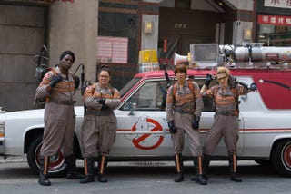 Illustration for article titled First picture of the new Ghostbusters in front of the ECTO-1 is badass