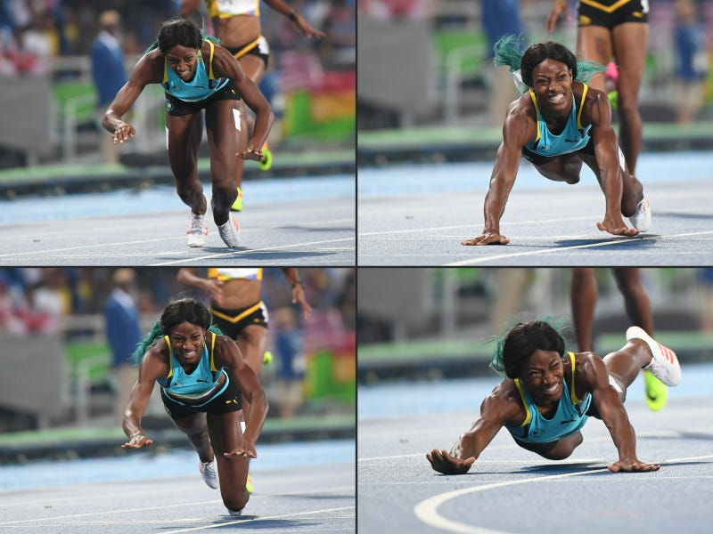 This combination of pictures created Aug. 15, 2016, shows Bahamas' Shaunae Miller diving to cross the finish line to win the women's 400-meter final during the  Rio de Janeiro 2016 Olympic Games on Aug. 15, 2016.OLIVIER MORIN/AFP/Getty Images