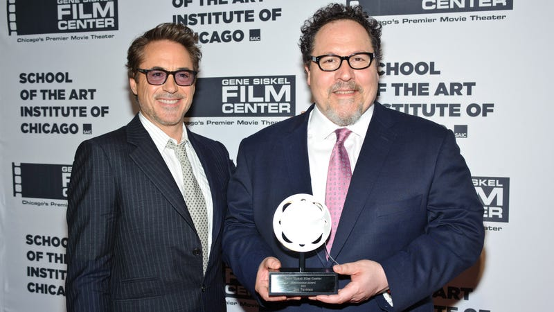 Jon Favreau receives his Renaissance Award at the 2019 Gene Siskel Film Center Gala, with BFF Robert Downey Jr. by his side