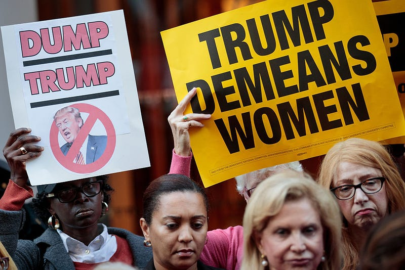 "Activists rally during a protest against Donald Trump for his ""treatment of women"" Oct. 17, 2016, in front of Trump Tower in New York City. Drew Angerer/Getty Images"
