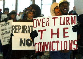 Protesters march in front of city court in New York 05 December, 2002 over five men charged with the 1989 sexual assault on a jogger in Central Park.DOUG KANTER/AFP/Getty Images
