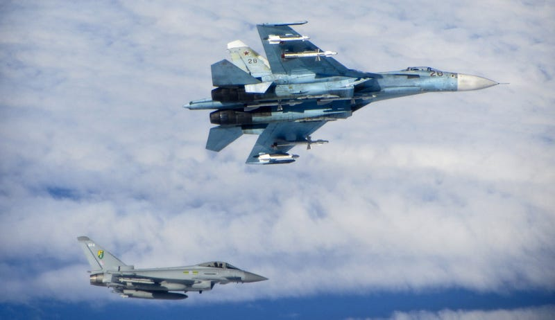 Illustration for article titled Photos of NATO fighters intercepting fully armed Russian jets