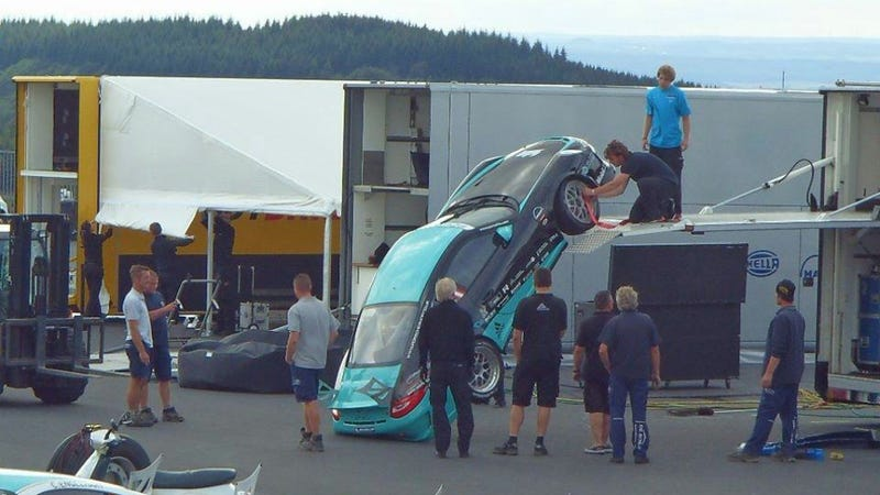Illustration for article titled How Not To Unload A $250k Porsche GT3 Race Car