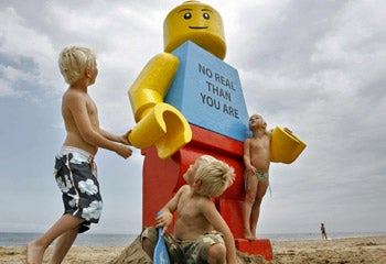 Illustration for article titled Giant Lego Man Bobs up on the Coast of the Netherlands