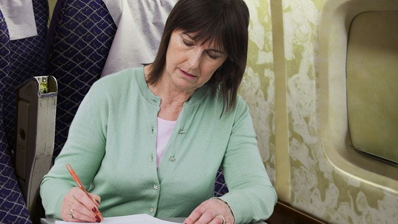 teacher grading papers next to you on plane not pulling any punches