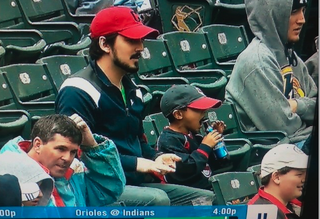 Illustration for article titled Here's A Photo Of A Very Young Indians Fan About To Pound A Bottle Of Bud Light