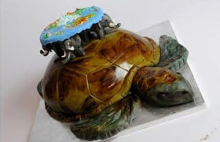 Illustration for article titled Discworld Cake Is Almost Too Wonderful To Eat
