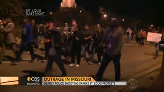 Demonstrators take to the streets in protest in St. Louis, Mo., after the deadly shooting Wednesday of a black teen by white a white officer.CBS-TV Screenshot