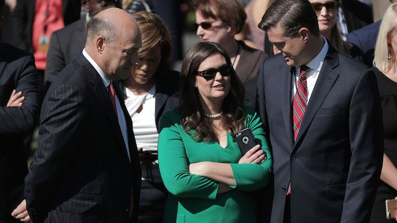 Porter on the right, with Gary Cohn and Sarah Sanders. Image via Getty.
