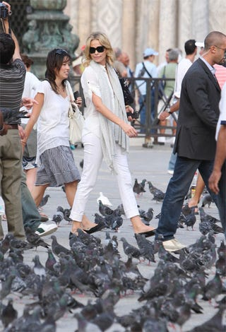 Illustration for article titled Charlize Theron's All-White Outfit Goes Well With Pigeon-Poop