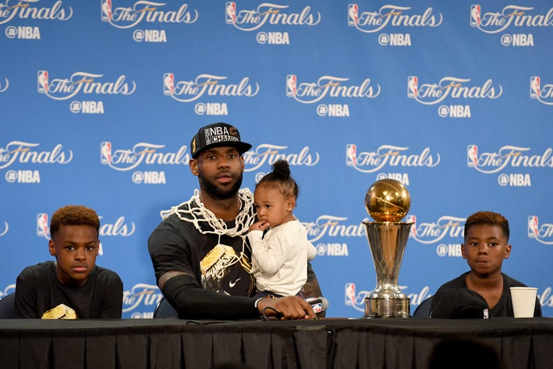 LeBron James of the Cleveland Cavaliers sits with his children, LeBron Jr., Zhuri and Bryce, during the postgame press conference after defeating the Golden State Warriors on June 19, 2016, to win the NBA Finals in Oakland, Calif.Thearon W. Henderson/Getty Images