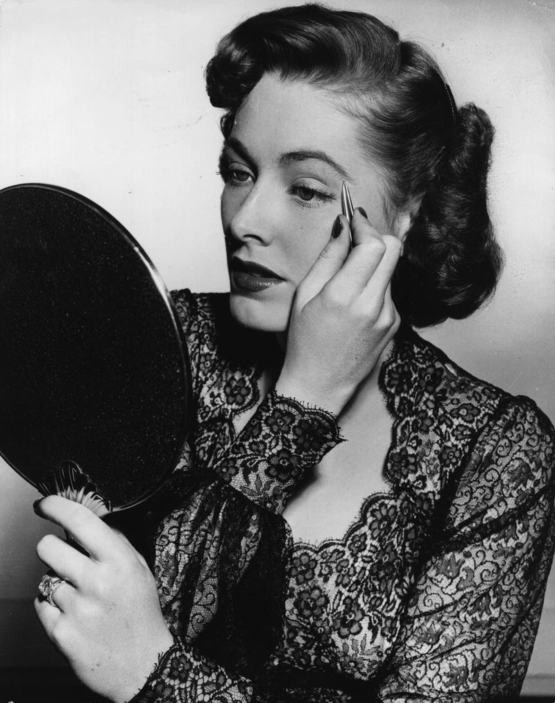 Illustration for article titled Don't Mind This Actress from the 1940s, Plucking Her Eyebrows