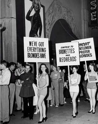 """Illustration for article titled Brunettes, Redheads Picket """"Gentlemen Prefer Blondes"""""""