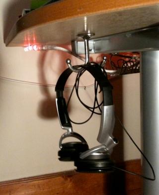 A Coat Hook Under Your Desk Keeps Headphones Neatly Tucked