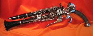 Illustration for article titled Clarinet Gun Mod Artwork is Not for Band Practice