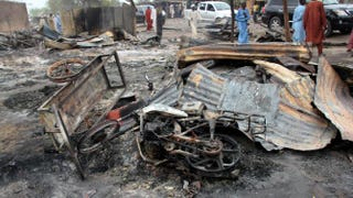 A burned motorcycle lies in a street of the remote northeast town of Baga on April 21, 2013, after two days of clashes between officers of the Joint Task Force and members of the Islamist sect Boko Haram on April 19 in the town near Lake Chad, 200 km north of Maiduguri, in Borno state.STRINGER/AFP/Getty Images