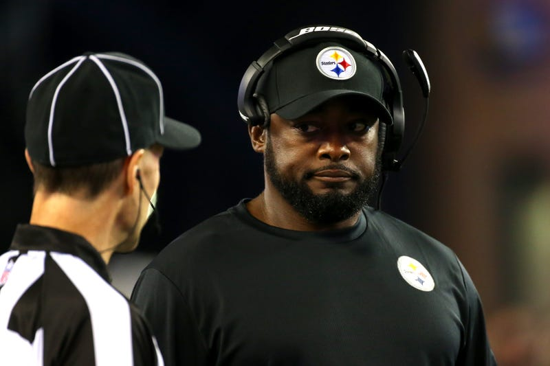 Head coach Mike Tomlin of the Pittsburgh Steelers speaks to an official in the first half against the New England Patriots at Gillette Stadium on Sept. 10, 2015, in Foxboro, Mass. (Jim Rogash/Getty Images)