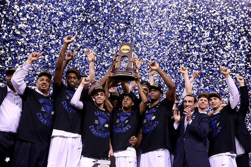 The Duke Blue Devils celebrate with the championship trophy after defeating the Wisconsin Badgers 68 to 63 during the NCAA Men's Final Four National Championship at Lucas Oil Stadium on April 6, 2015, in Indianapolis. (Streeter Lecka/Getty Images)