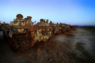 Illustration for article titled Gloomy tank graveyards hold the rusting bones of war