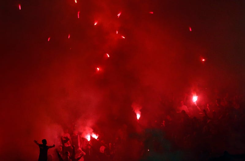 Illustration for article titled Smoke, Flares, Riot Police In Belgrade Derby Make For Haunting Photos